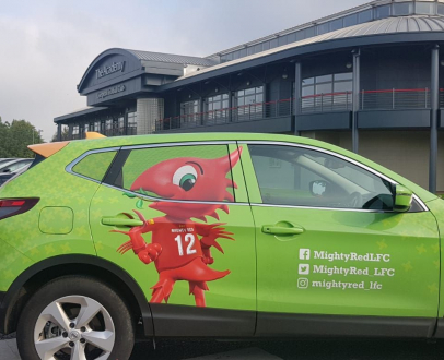 Win the chance to travel to school in the Mighty Red Mobile!