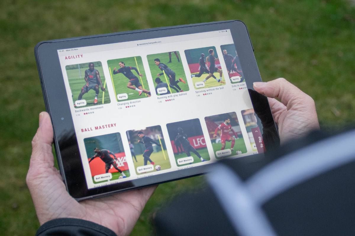 A parent uses LFC eAcademy on a tablet device