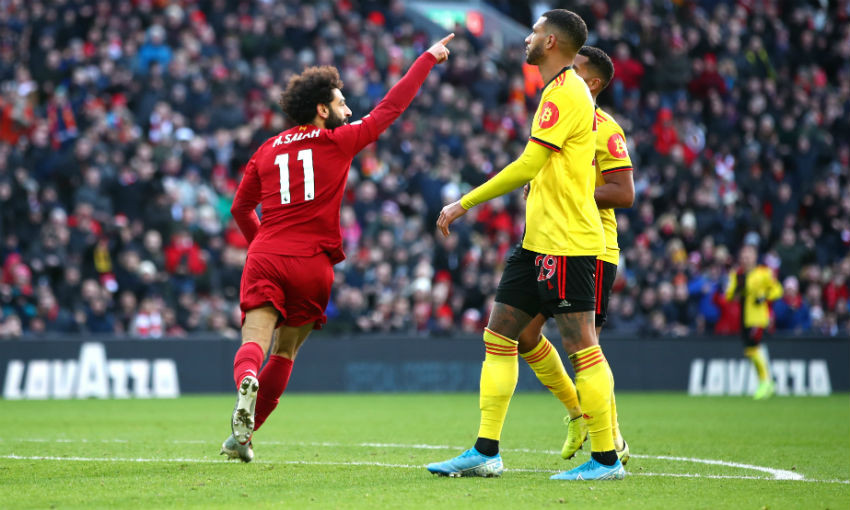 Mohamed Salah of Liverpool celebrates his sides first goal during the Premier League match between Liverpool FC and Watford FC at Anfield on December 14, 2019 in Liverpool, United Kingdom.