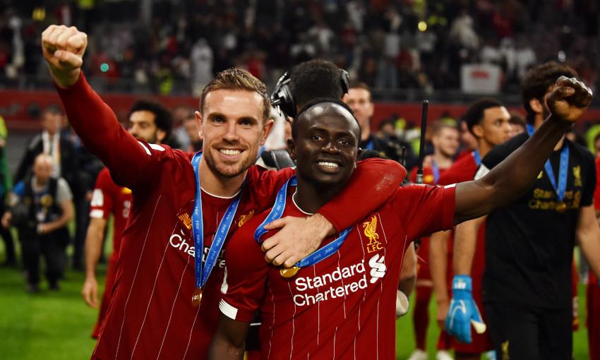 Jordan Henderson and Sadio Mane celebrate FIFA Club World Cup win