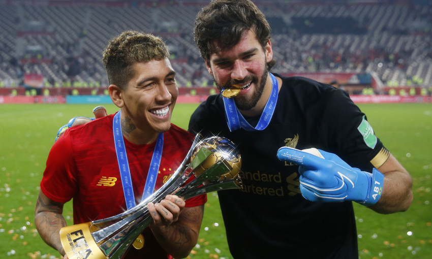 Roberto Firmino and Alisson Becker