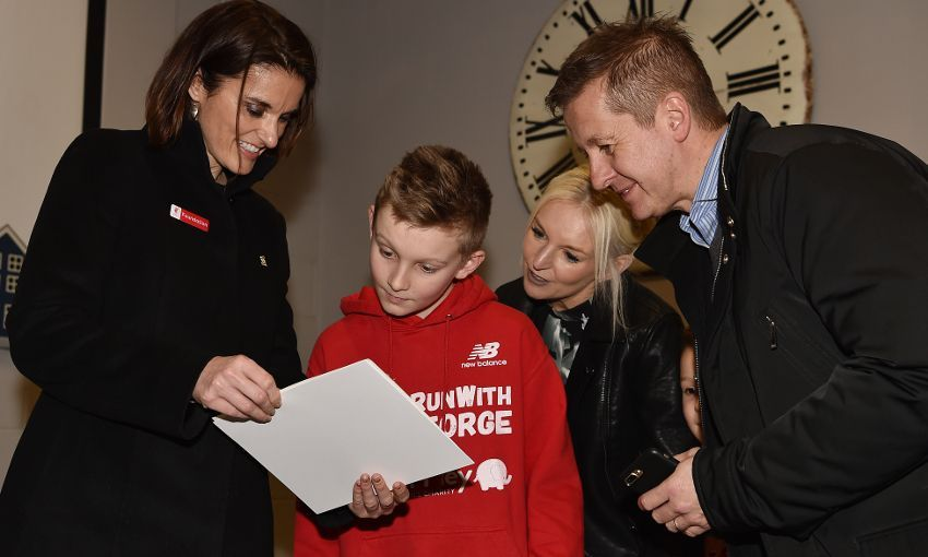 George Mathias is presented award from Liverpool LFC Foundation