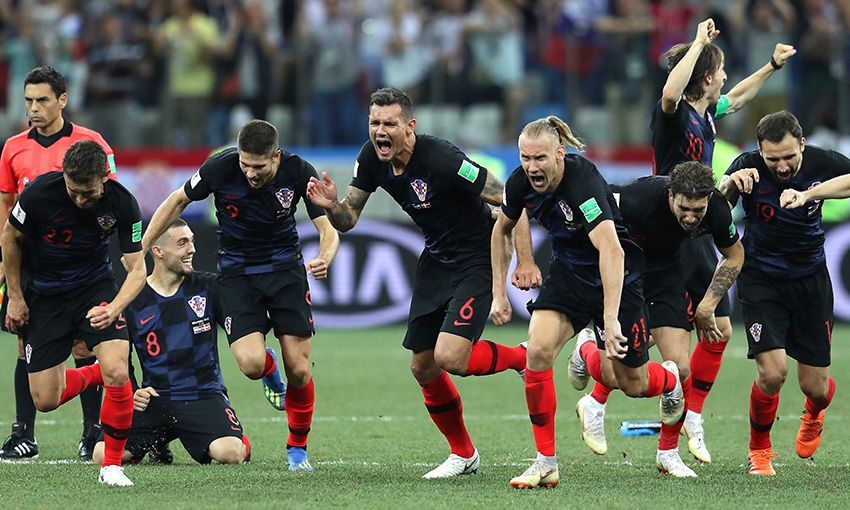 Dejan Lovren celebrates Croatia's penalty shootout win against Denmark.