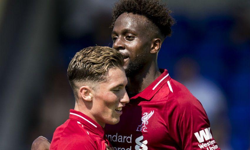 Harry Wilson and Divock Origi celebrate a goal for Liverpool FC