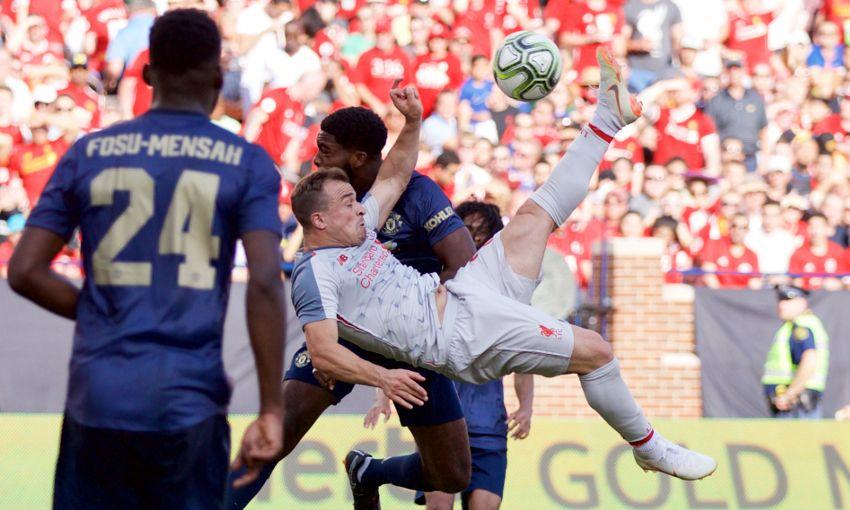 Xherdan Shaqiri scores an overhead kick against Manchester United