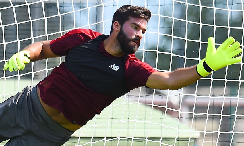 Alisson Becker trains with Liverpool in Evian, France.