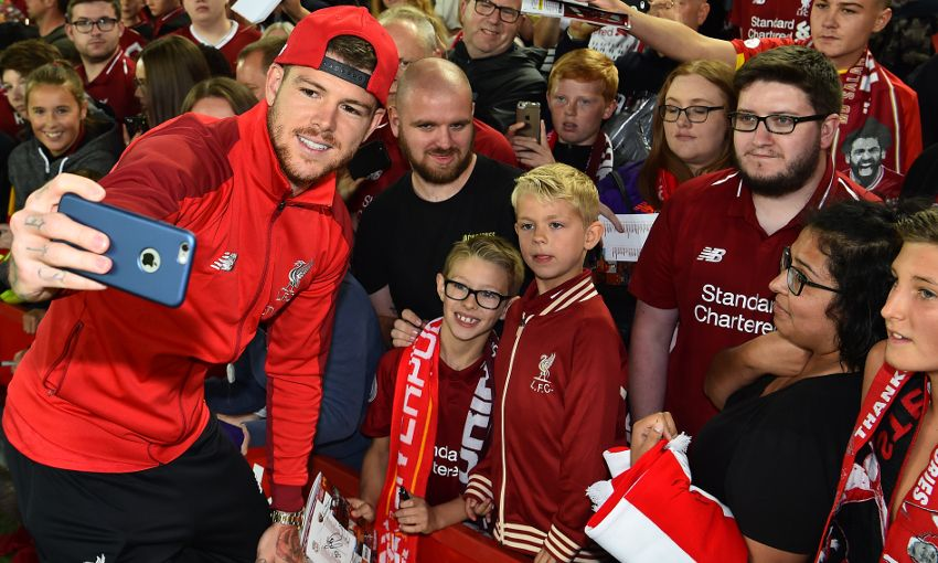 Alberto Moreno poses with Liverpool fans at Anfield after the win over Torino.