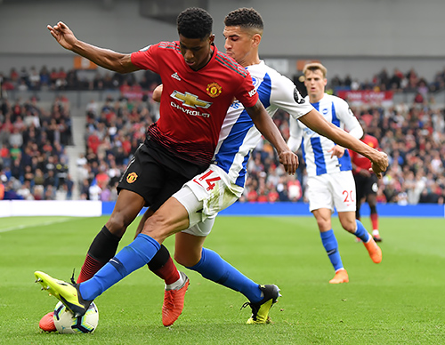 Brighton's Leon Balogun in action against Manchester United.