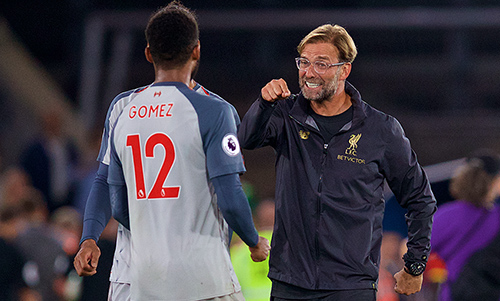 Liverpool manager Jürgen Klopp celebrates with defender Joe Gomez