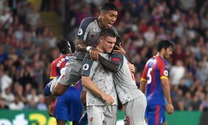 Liverpool's James Milner celebrates scoring from the penalty spot against Crystal Palace