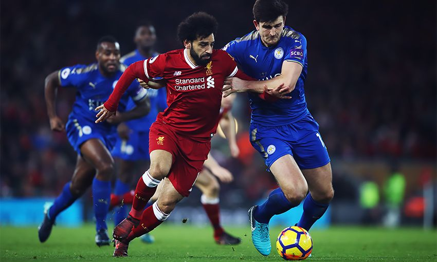 Liverpool's Mohamed Salah battles with Leicester City defender Harry Maguire