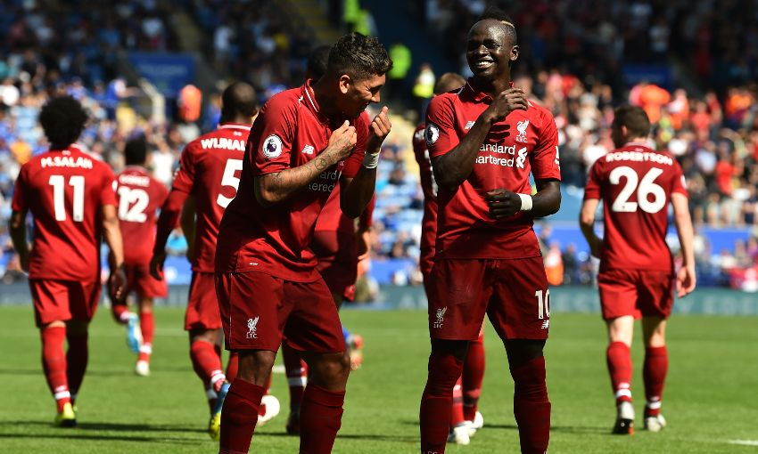 Roberto Firmino and Sadio Mane celebrate a Liverpool goal