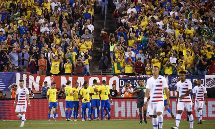 Brazil celebrate a goal against USA