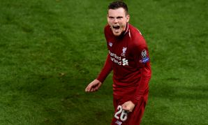 Andy Robertson celebrates Liverpool's win over PSG