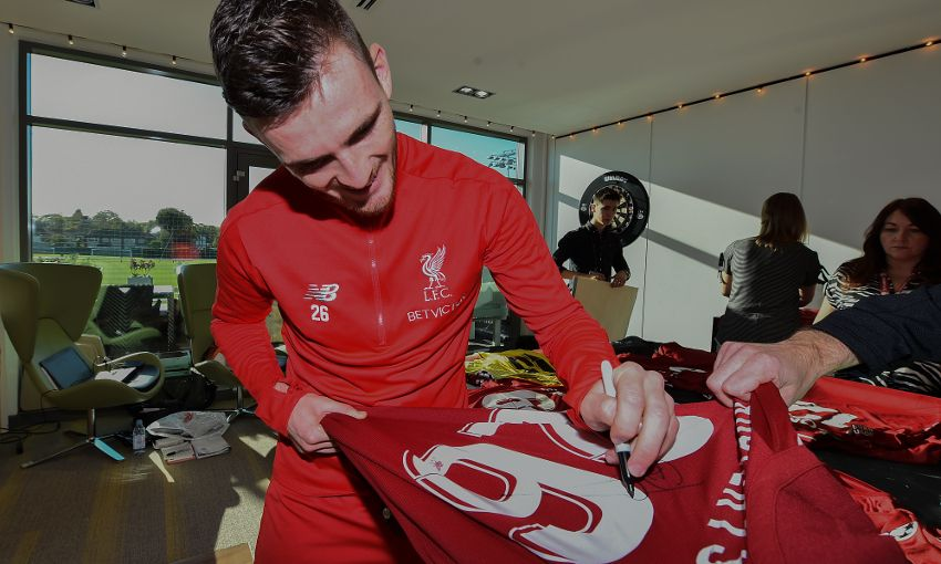 f22c43d8398 Reds sign shirts for Indonesia Tsunami Appeal - Liverpool FC