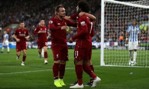 Xherdan Shaqiri and Mohamed Salah celebrate during Liverpool FC v Huddersfield Town