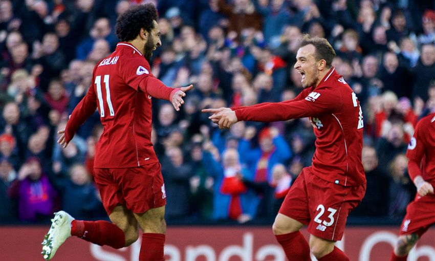 Xherdan Shaqiri celebrates with Mohamed Salah