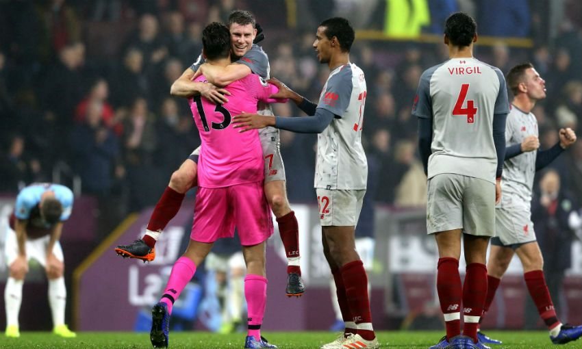 Liverpool FC players celebrate victory versus Burnley