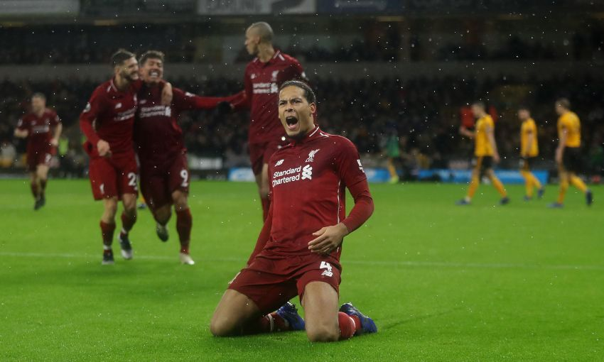 Virgil van Dijk celebrates scoring against Wolves