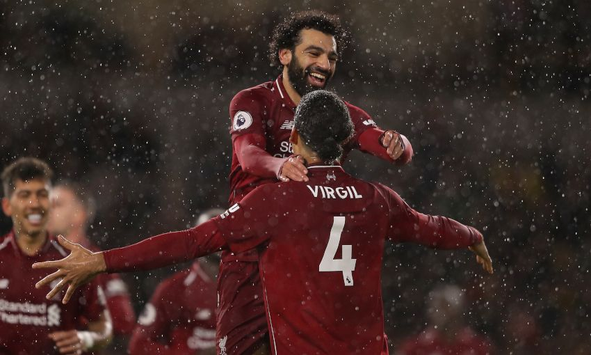 Mohamed Salah and Virgil van Dijk celebrate