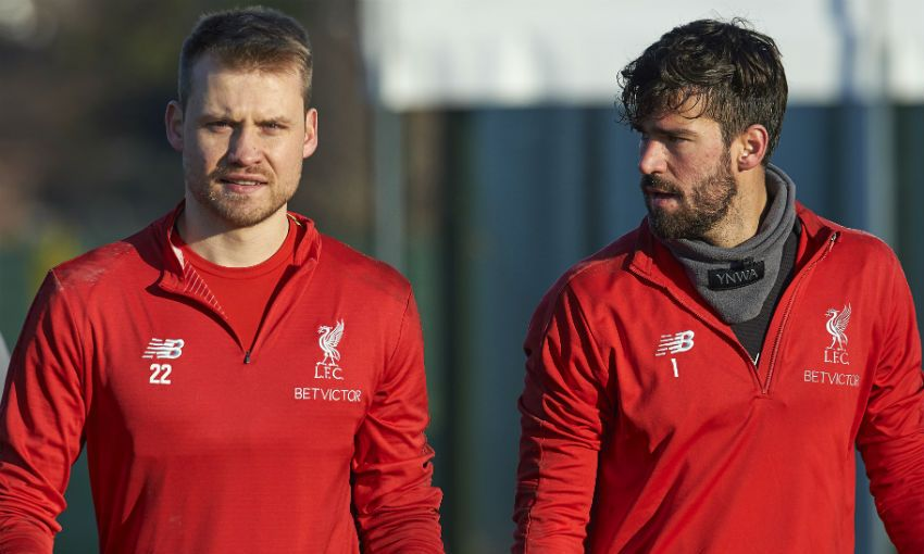 Alisson Becker and Simon Mignolet of Liverpool FC