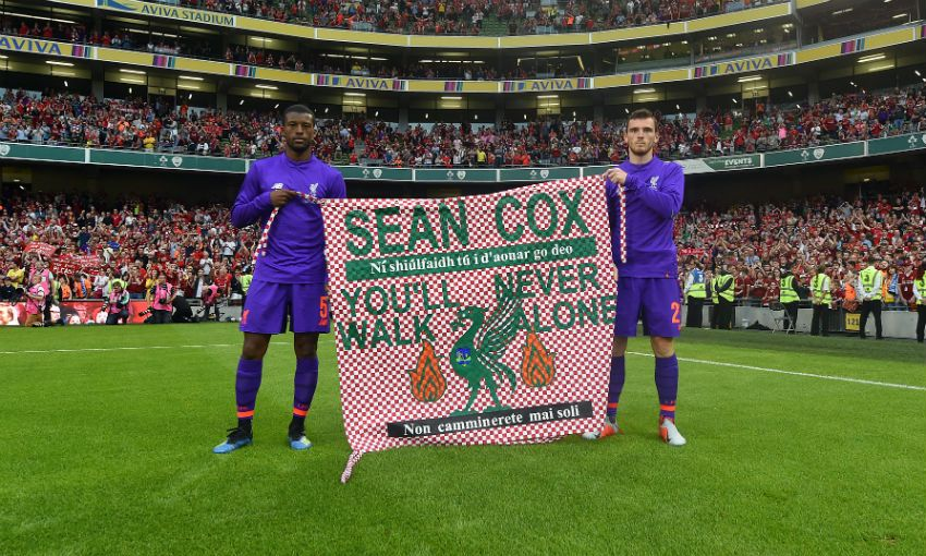 Georginio Wijnaldum and Andy Robertson show support for Liverpool FC fan Sean Cox