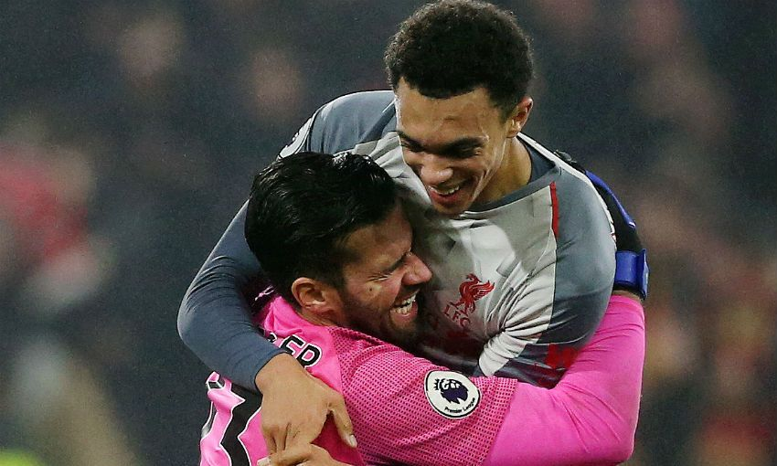 Trent Alexander-Arnold and Alisson Becker of Liverpool FC