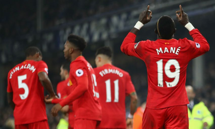 Sadio Mane of Liverpool FC celebrates scoring versus Everton