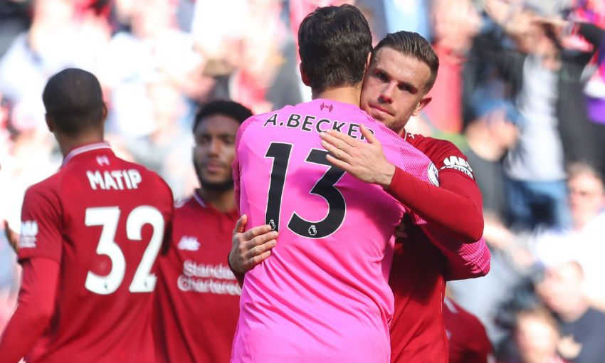 Jordan Henderson and Alisson Becker of Liverpool FC
