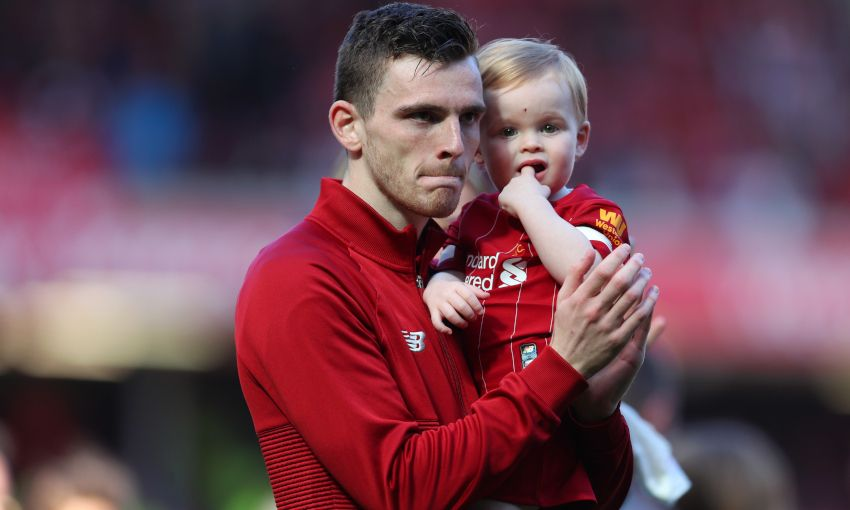 Andy Robertson applauds the fans after Liverpool v Wolves
