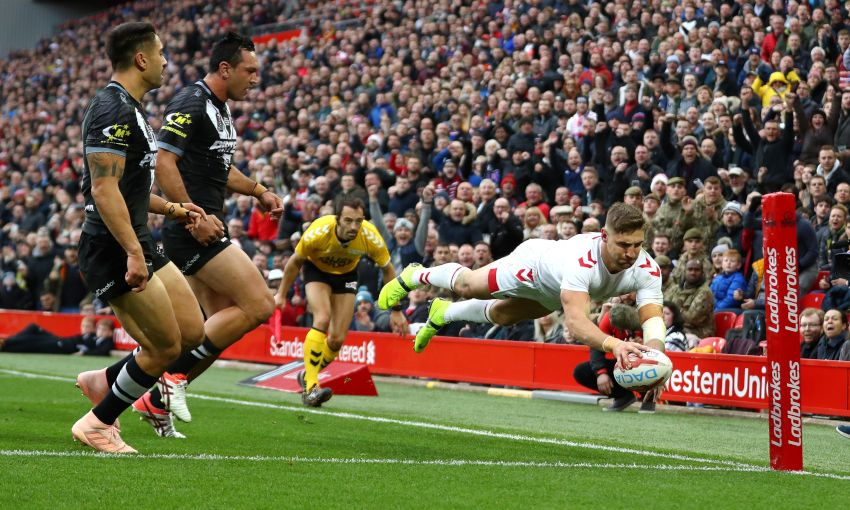 Tommy Makinson scores a try at Anfield