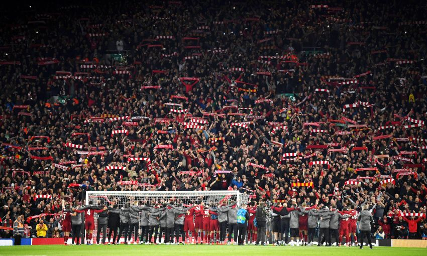 Players and fans celebrate Liverpool's win over Barcelona at Anfield