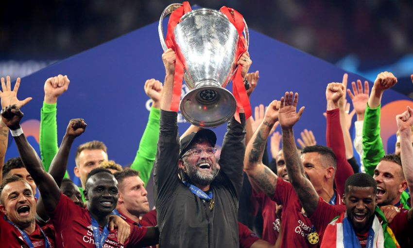 Jürgen Klopp lifts the Champions League trophy after Liverpool beat Tottenham in Madrid