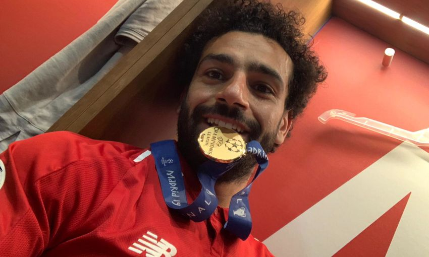 Mohamed Salah celebrates Champions League final win