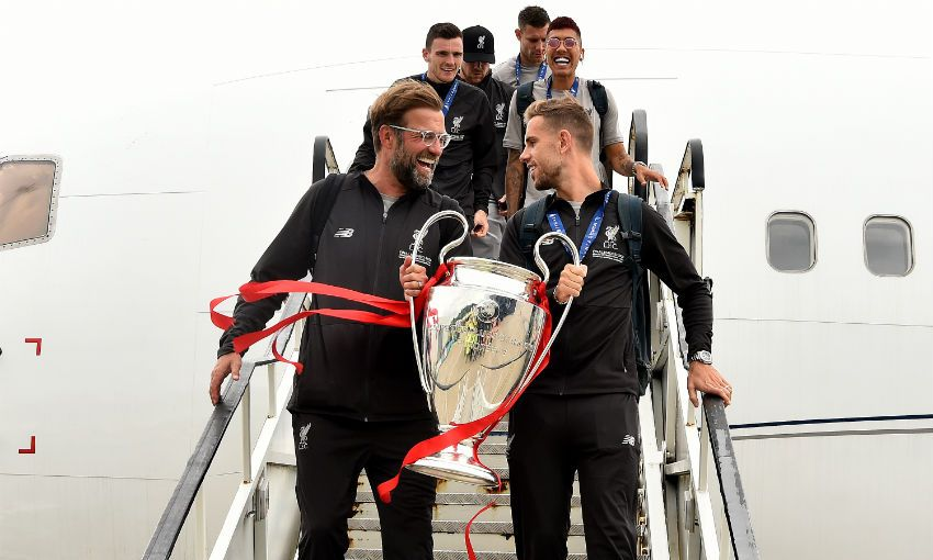 Jürgen Klopp and Jordan Henderson return to Liverpool with Champions League trophy