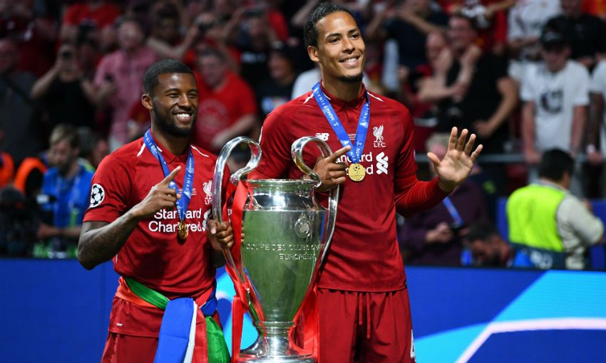 Virgil van Dijk and Gini Wijnaldum with Champions League trophy