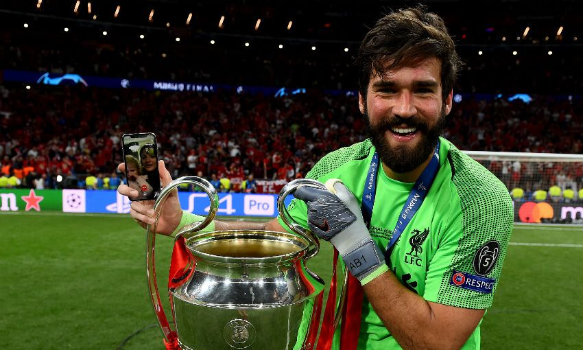 Alisson Becker with the Champions League trophy