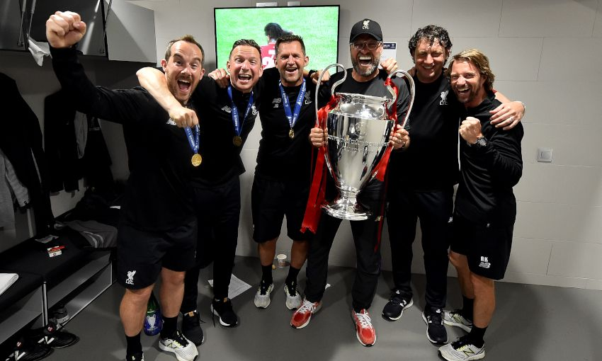 Jürgen Klopp and his coaching team with the Champions League trophy