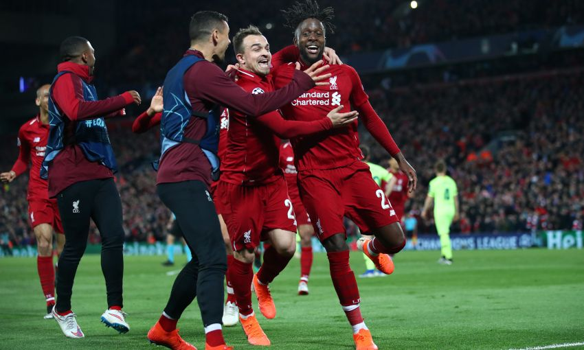 Divock Origi celebrates scoring against Barcelona