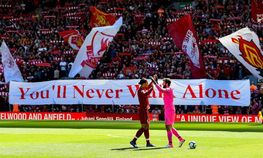 Alisson Becker and Virgil van Dijk of Liverpool FC at Anfield