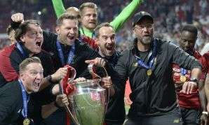 Liverpool coaching staff with Champions League trophy