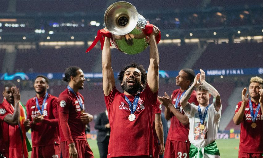 Mohamed Salah with Champions League trophy