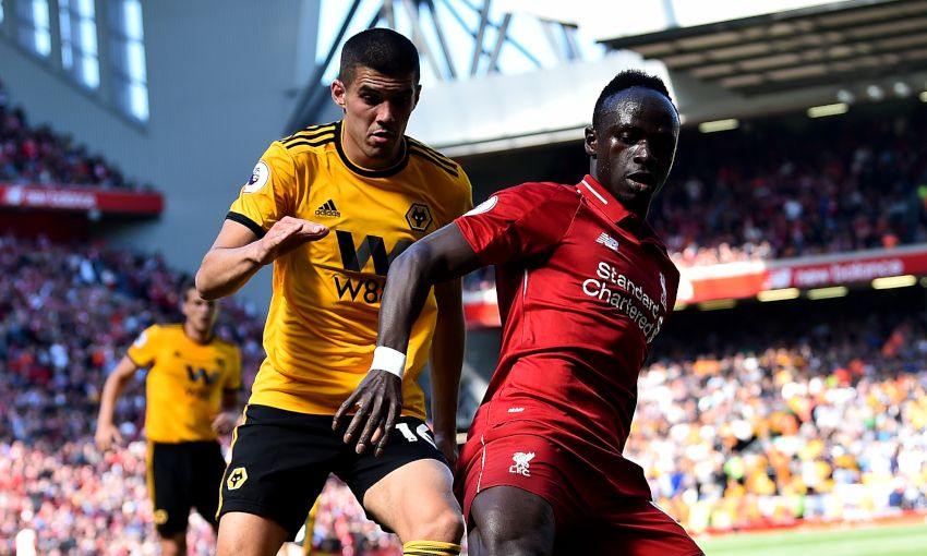 Conor Coady and Sadio Mane compete at Anfield