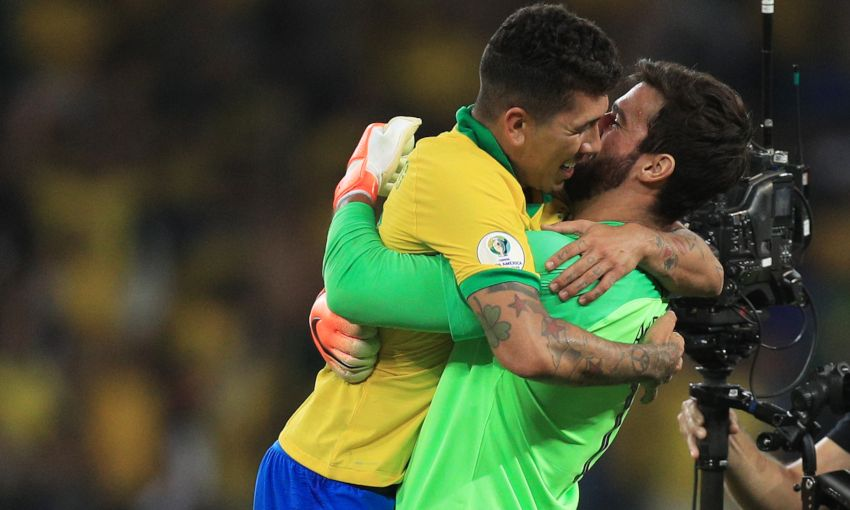 Roberto Firmino and Alisson Becker celebrate victory with Brazil
