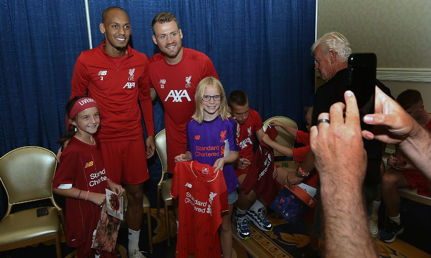 Liverpool players sign autographs for US children