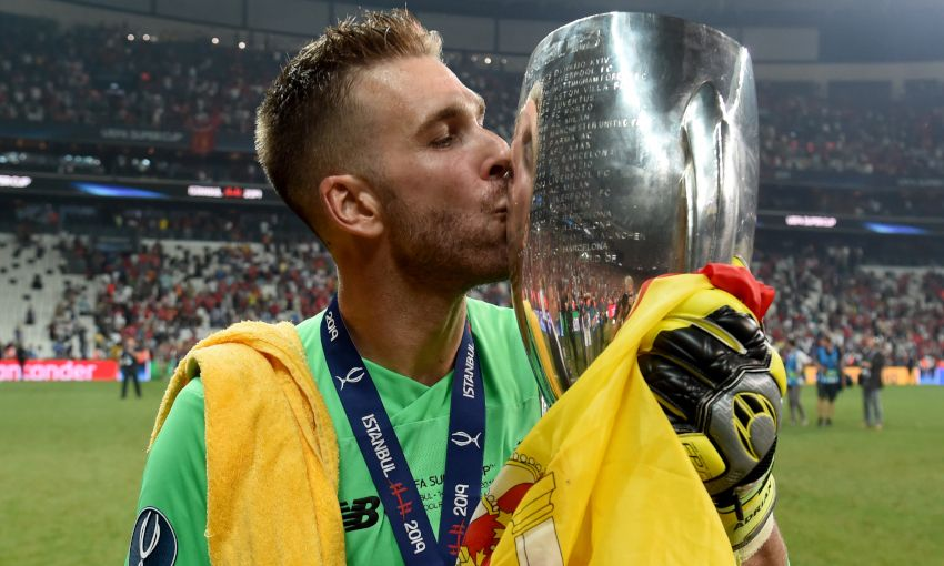 Adrian celebrates with the UEFA Super Cup