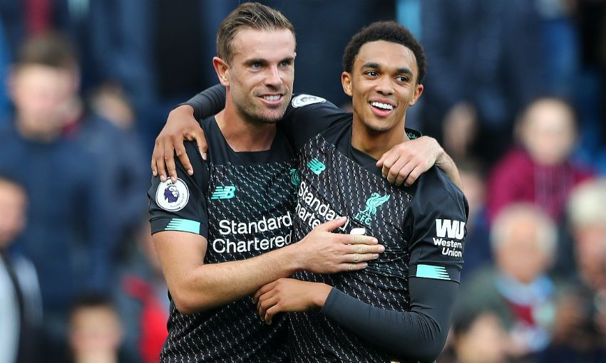 Jordan Henderson and Trent Alexander-Arnold of Liverpool FC