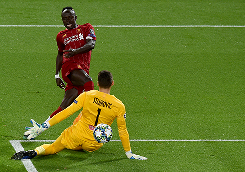 Salah scores twice as Liverpool survive seven-goal thriller with Salzburg