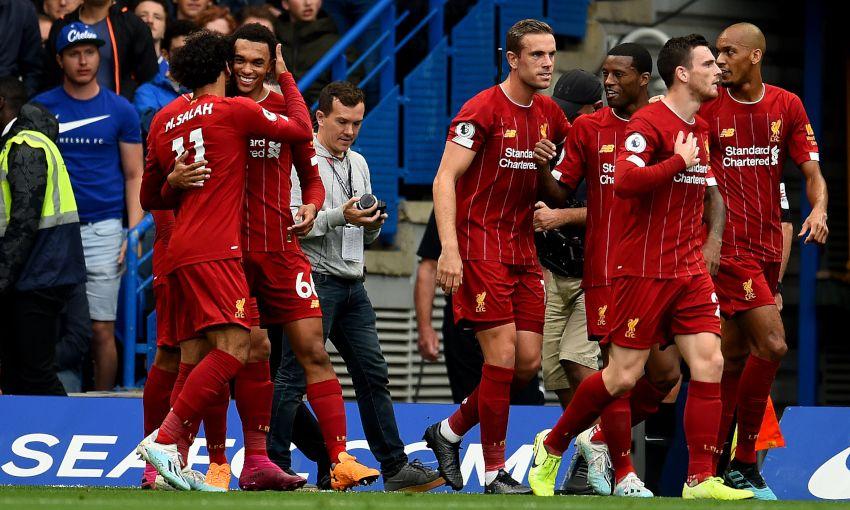 Trent Alexander-Arnold celebrates scoring against Chelsea