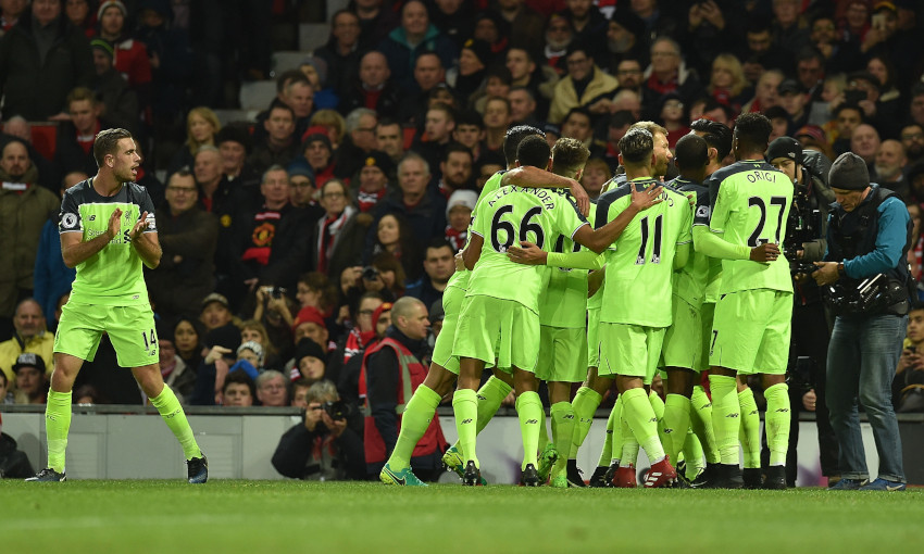Liverpool celebrate a goal at Old Trafford